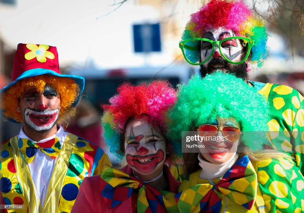 People dressed as clowns pose for the photo during the Carnival Clown's Parade at Sesimbra village on February 12, 2018.