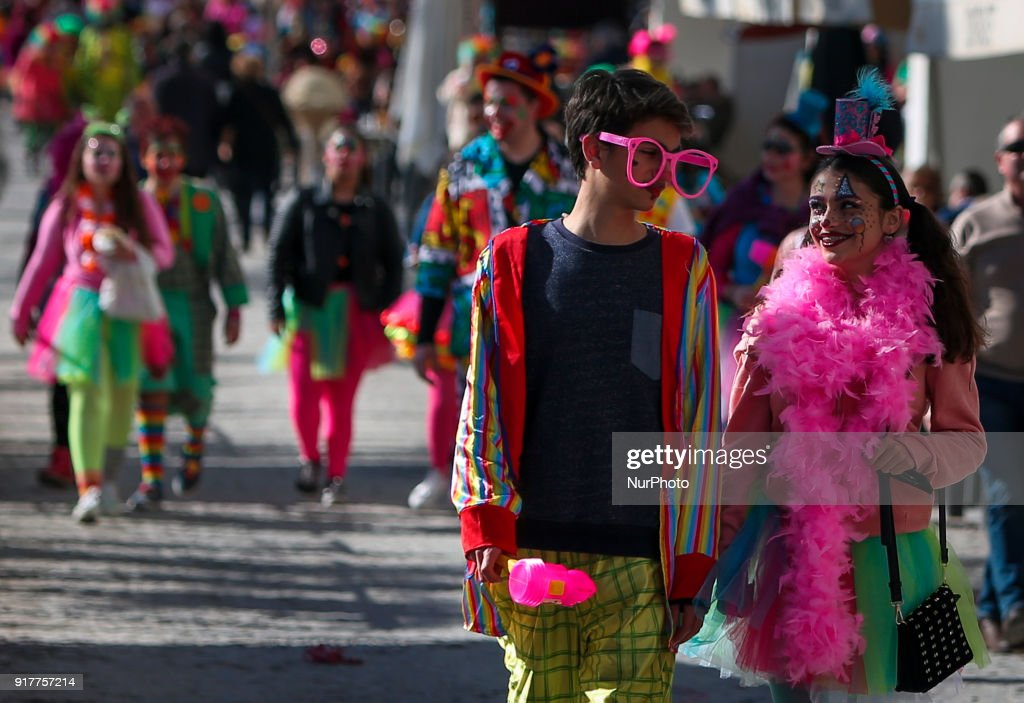 People dressed as clowns take part on the Carnival Clown's Parade at Sesimbra village on February 12, 2018.