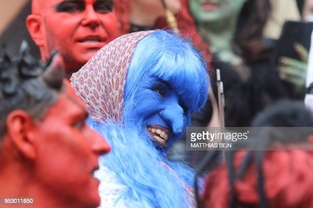 People dressed as devils ans witches pose on the market square of Wernigerode central Germany on April 30 as they celebrate the socalled Walpurgis...