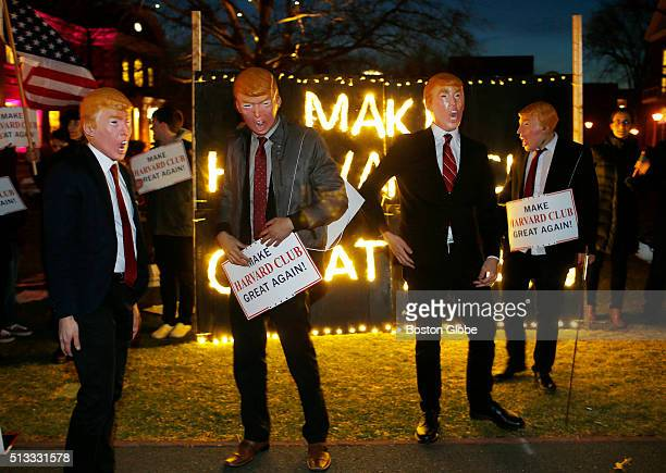 People dressed as Donald Trump rally to 'Make Harvard Club Great Again' outside of a Harvard Alumni event at the Harvard Business School in Boston on...