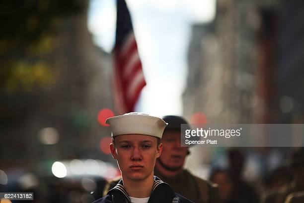 People dressed as First World War soldiers march in the Veterans Day Parade in New York City on November 11 2016 in New York City Known as 'America's...