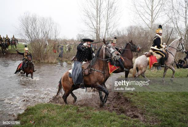 People dressed as Hungarian Hussars and Hapsburg Austrian soldiers reenact the Battle of Tapiobicske on April 4 2018 near Cegled Hungary The 1848...