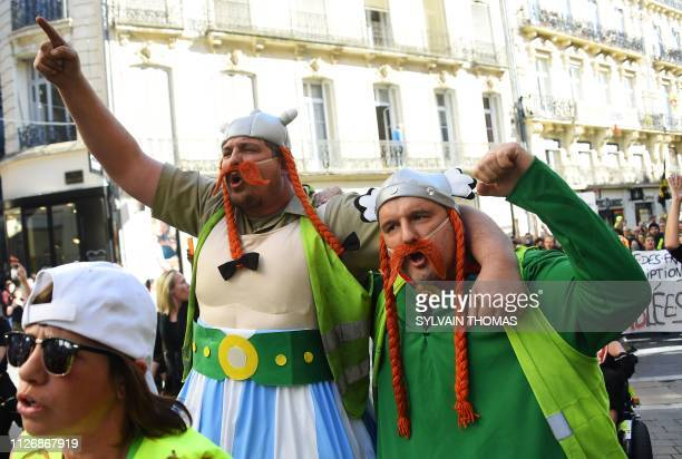 TOPSHOT People dressed as Obelix and Asterix take part in a Yellow Vest antigovernment demonstration in Montpellier southern France on February 23...