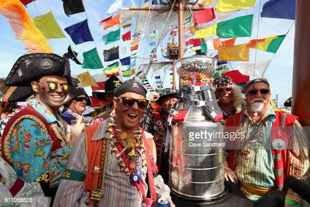 People dressed as pirates pose for a group shot with the stanley cup onboard the Gasparilla as part of the 2018 NHL AllStar weekend on January 27...