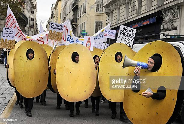 People dressed as potatoes simulate a protest during the shooting of a commercial for cooking oil on December 3 2008 in Marseille south eastern...