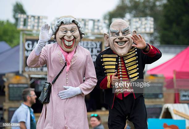 People dressed as Queen Elizabeth II and Prince Philip Duke of Edinburgh attend the Isle Of Wight Festival 2016 at Seaclose Park on June 12 2016 in...