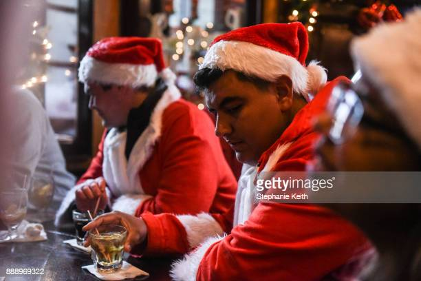 People dressed as Santa Claus participate in the annual bar crawl SantaCon on December 9 2017 in New York City The annual bar crawl of festive...