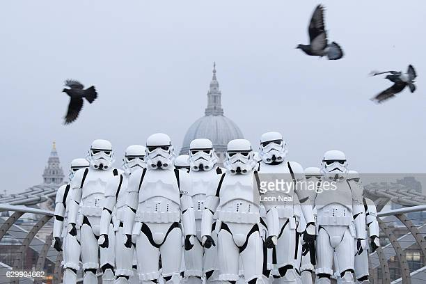 People dressed as Stormtroopers from the Star Wars franchise of films pose on the Millennium Bridge to promote the latest release in the series Rogue...
