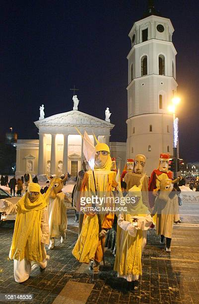 People dressed as the Three Kings along with residents and city guests celebrate the Three Kings day in the old district of Vilnius on January 6...