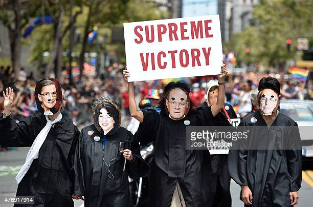 People dressed as The United States Supreme Court Justices march along Market Street during the annual Gay Pride Parade in San Francisco California...