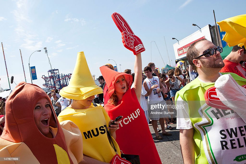 People dressed as various condiments cheer prior to the Nathan's Famous International Hot Dog Eating Contest at Coney Island on July 4, 2012 in the Brooklyn borough of New York City. Joey Chestnut won the men's division by successfully tying his own world record by eating 68 hot dogs in 10 minutes; he has now won the competition six years in a row.