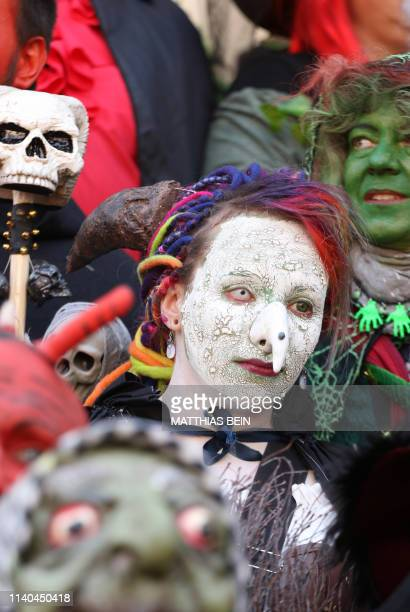 People dressed as witches and devils take part in an event to celebrate Walpurgis Night in Wernigerode central Germany at the foot of the Brocken...
