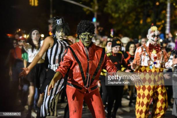 People dressed as zombies dance to Michael Jackson's song Thriller during the annual Village Halloween parade on Sixth Avenue on October 31 2018 in...