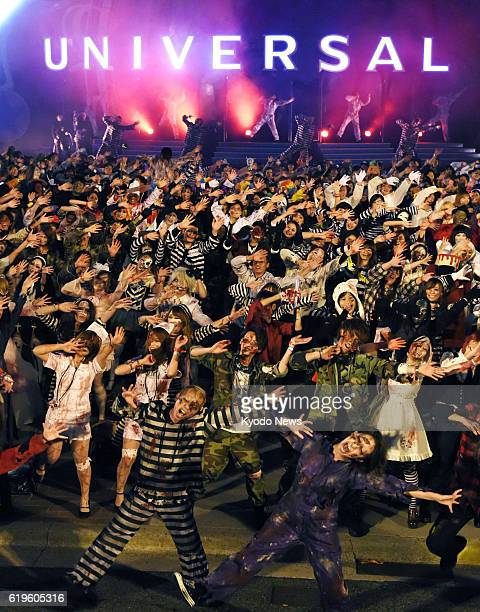 People dressed as zombies join the Halloween event at Universal Studios Japan in Osaka on Oct 31 2016 Around 3000 participants danced to Michael...