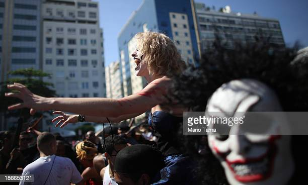 People dressed as zombies march in the 'Zombie Walk' along Copacabana Beach during Day of the Dead festivities on November 2 2013 in Rio de Janeiro...