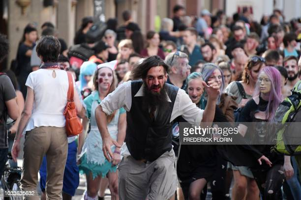People dressed as zombies take part in the Zombie Walk event on September 15 2018 in the eastern French city of Strasbourg within the framework of...