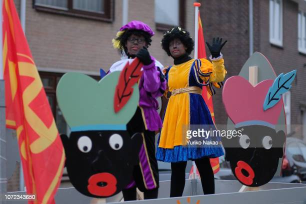 People dressed as Zwarte Piet or Black Pete attend a parade with Sinterklaas November 24 in Katwijk Netherlands Recently the traditional blackfaced...