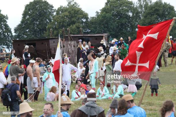 People dressed in a funny way are seen in Grunwald Poland on 13 July 2018 Battle of Grunwald reenactment participants take part in the last rehearsal...