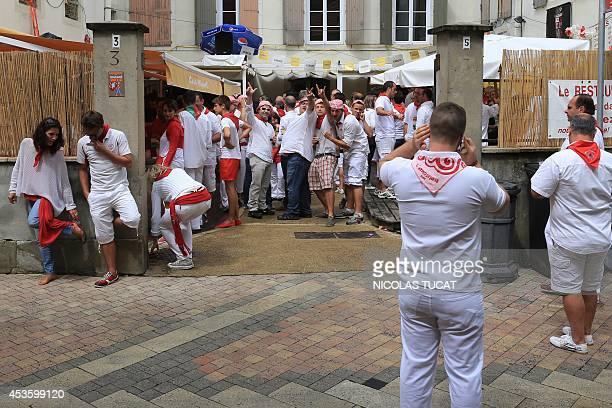 People dressed in basque traditional clothing gather in a pub in Dax southwestern France on August 14 2014 during the 'Fetes de Dax' traditionnal...