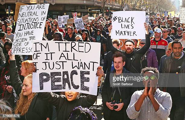 People dressed in black clothes rally to support the Black Lives Matter movement on July 17 2016 in Melbourne Australia The rallies were organised in...