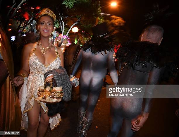 People dressed in colorful Halloween costumes parade along Santa Monica Blvd during the annual street Halloween festival in West Hollywood California...
