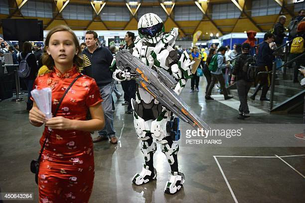 People dressed in costume attend the Supanova Pop Culture Expo in Sydney on June 15 2014 The threeday event in which thousands of fans dress up in...