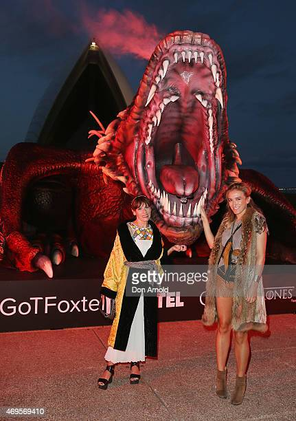 People dressed in costume pose at the Sydney premiere of Game Of Thrones at Sydney Opera House on April 13 2015 in Sydney Australia