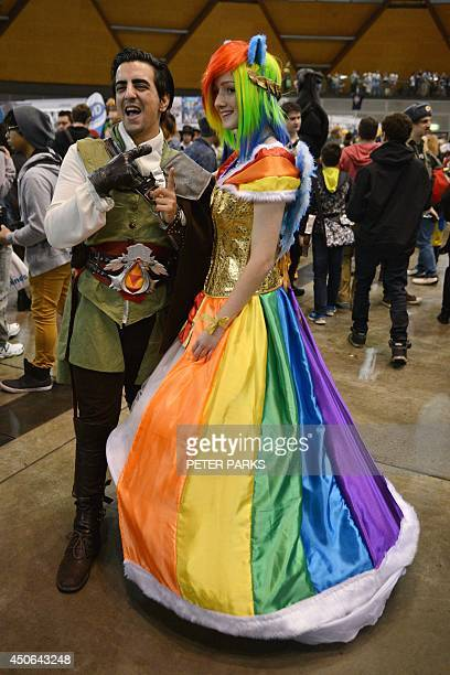 People dressed in costume pose for photos as they attend the Supanova Pop Culture Expo in Sydney on June 15 2014 The threeday event in which...