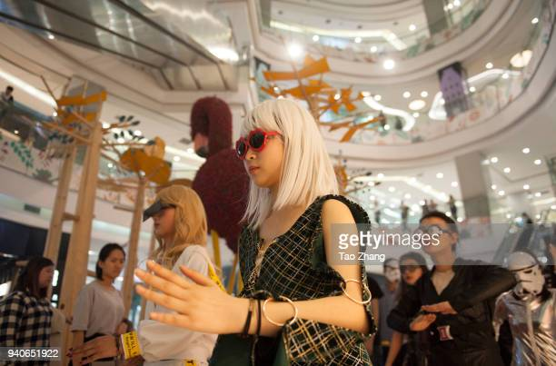People dressed in costumes participate in a flash mob in a mall to mark April Fool's Day on April 1 2018 in Harbin China