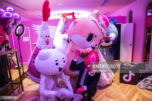 People dressed in costumes pose for photographs during the TikTok Creator's Lab 2019 event hosted by Bytedance Ltd in Tokyo Japan on Saturday Feb 16...