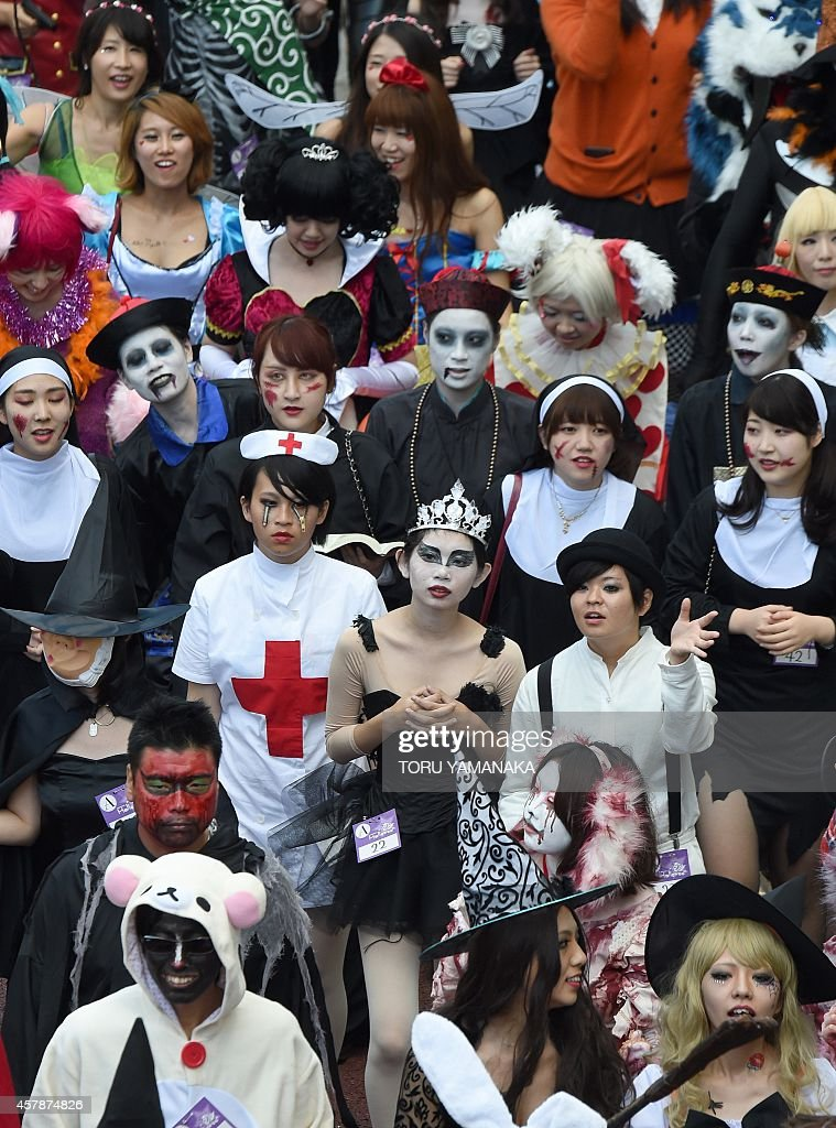 People dressed in costumes take part in the Halloween Parade in Kawasaki, suburb of Tokyo, on October 26, 2014. More than 100,000 visitors watched the street costume parade in which some 2,500 people took part. AFP PHOTO/Toru YAMANAKA