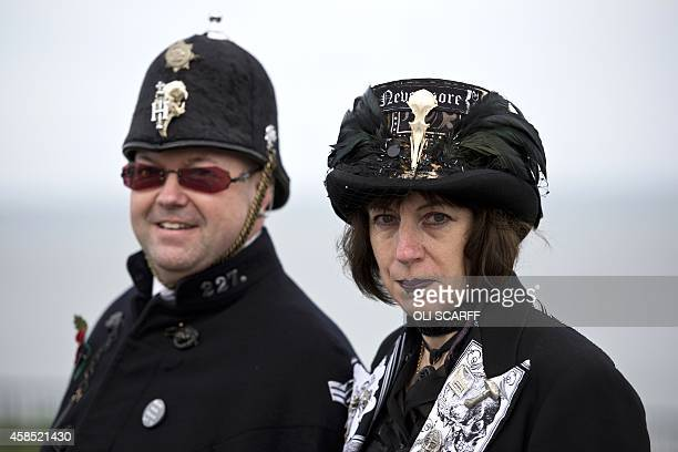 People dressed in gothic costumes attend the biannual Whitby Goth Weekend festival in Whitby Northern England on November 2 2014 The WGW festival...