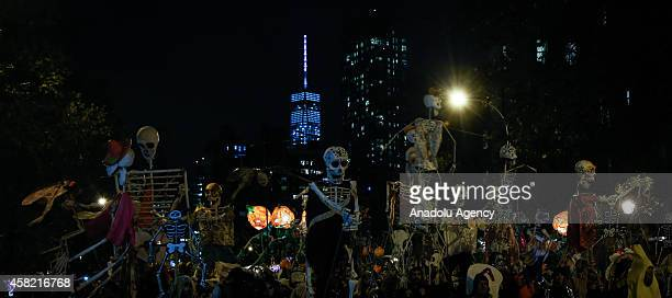 People dressed in Halloween costume take part in Halloween celebrations held within 41st annual Village Halloween parade under the theme of 'The...