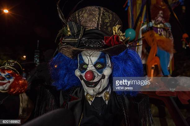 People dressed in Halloween costume take part in Halloween celebrations held within 43rd annual Village Halloween parade October 31 2016 in New York