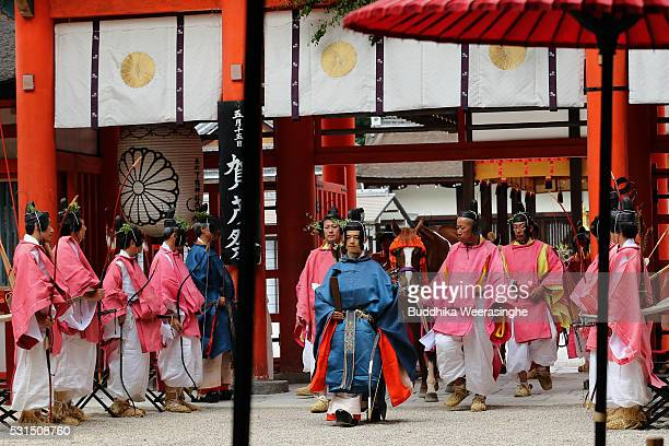 People dressed in Heian Period costumes walk in the procession of the Aoi Festival at Shimogamo Shrine on May 152016 in Kyoto Japan Aoi Festival is...