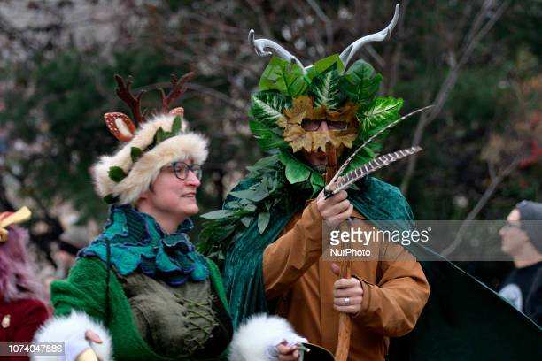 People dressed in horned Krampus costumes participate in the eight annual Parade of Spirits Krampus Parade through the Northern Liberties...