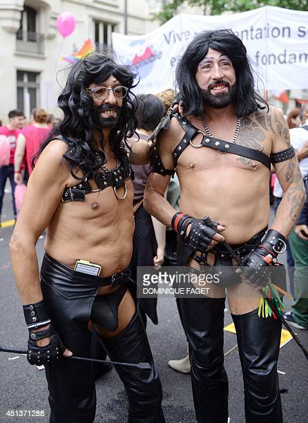 People dressed in leather take part in the lesbian gay bisexual and transgender visibility march the Gay Pride under the rain on June 28 2014 in...