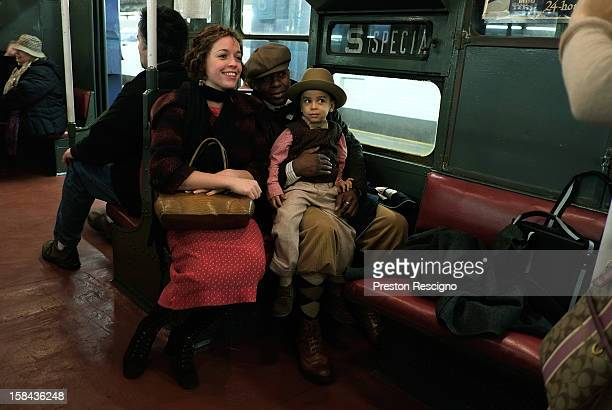 People dressed in period costumes have their picture taken in a vintage New York City subway car on December 16 2012 in New York City The New York...