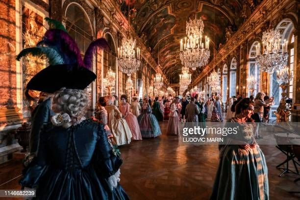 """People dressed in period costumes take part in the """"Fetes Galantes"""" fancy dress evening at the """"galerie des glaces"""" in the Chateau de Versailles on..."""
