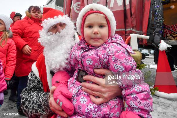 People dressed in Santa Claus costumes are seen during the 17th World Santa Clauses Summit parade held in Western Estonia county capital city Rakvere...