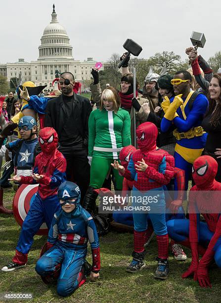 People dressed in superhero-style costumes line up for a photo near the US Capitol in Washington, DC on April 18 in an attempt to break a GUINNESS...