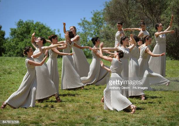People dressed in the robes of the ancient Greeks rehearse at the Temple of Hera in Olympia Greece where the ancient Olympic Games took place during...
