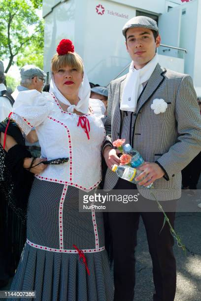 People dressed in the typical costumes of Chulapo and Chulapa visit 'La Pradera de San Isidro' park to mark St Isidro Madrid's patron saint day in...