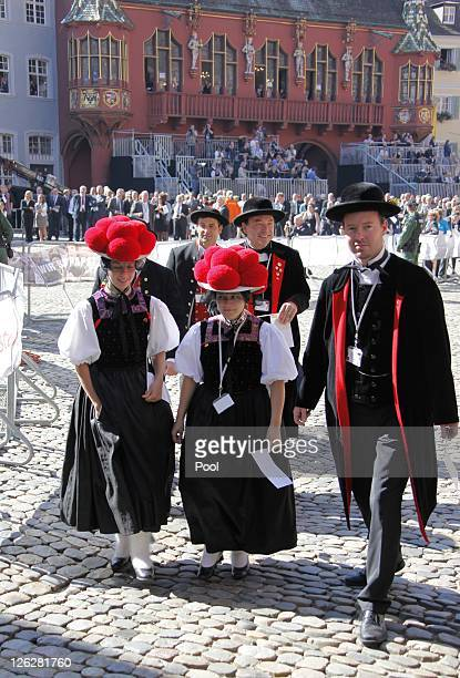 People dressed in traditional blackforest cloth attend Pope Benedict XVI visits the Muenster cathedral on September 24 2011 in Freiburg Germany The...
