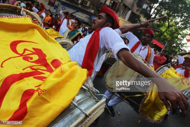 People dressed in traditional costumes takes part in the procession to celebrate the Hindu festival of Gudi Padwa or Maharashtrian New Year in...