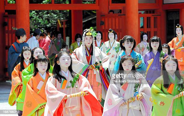 People dressed in traditional costumes walk in the procession of the Aoi Festival at the Imperial Palace on May 15 2013 in Kyoto Japan Aoi Festival...