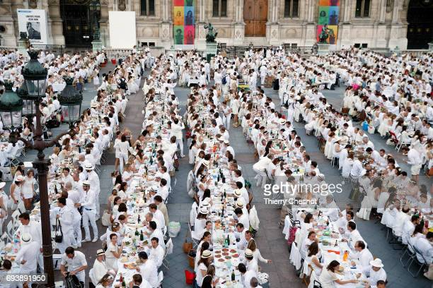 People dressed in white gather for the 29th 'Diner En Blanc' event in front of the Paris city hall on June 8 2017 in Paris France The Diner en Blanc...
