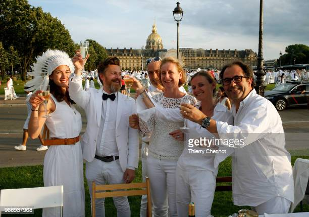 """People dressed in white gather for the 30th edition of the """"Diner En Blanc"""" event on the Invalides esplanade on June 3, 2018 in Paris, France. The..."""