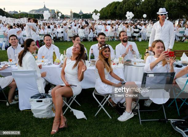People dressed in white gather for the 30th edition of the 'Diner En Blanc' event on the Invalides esplanade on June 3 2018 in Paris France The...