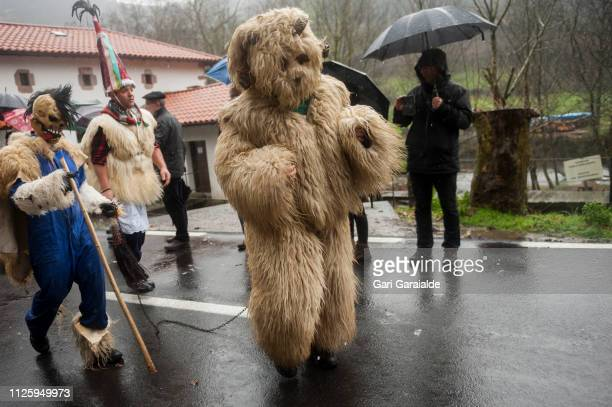 People dressed up as Bellringer Joaldunak in Basque and the bear perform during the celebration of an ancient traditional carnival on January 29 2019...